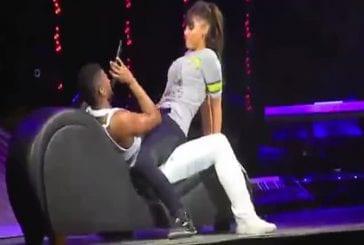 Usher et une fan faisant l'amour sur scène